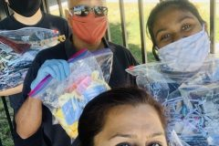 Harbir Bhatia with Suds Jain, Kevin Park and youth volunteer donating masks